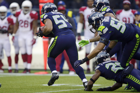 Rookie linebacker Bobby Wagner is off with a 45-yard interception return that began with teammates K.J. Wright and Walter Thurmond keeping the ball from Cardinals star Larry Fitzgerald. / Drew Sellers, Sportspress Northwest