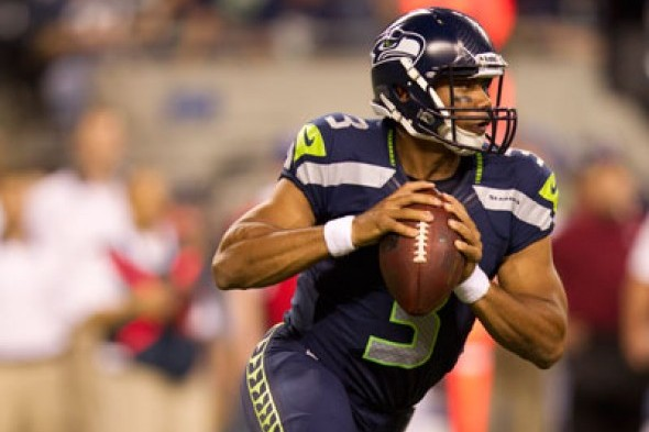 Russell Wilson threw for a franchise-record 385 yards in Seattle's 30-28 loss to the Atlanta Falcons Sunday in the Georgia Dome. / Drew Sellers, Sportspress Northwest