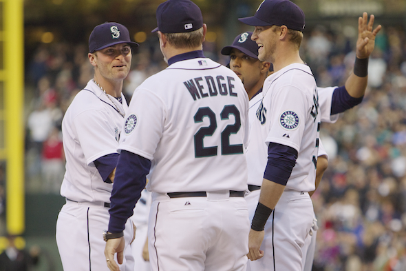 Greeting his manager, Eric Wedge, during introductions, Brendan Ryan demonstrated it was all sunshine, lollipops and no raindrops for the Mariners in their home opener Monday night. / Drew Sellers, Sportspress Northwest