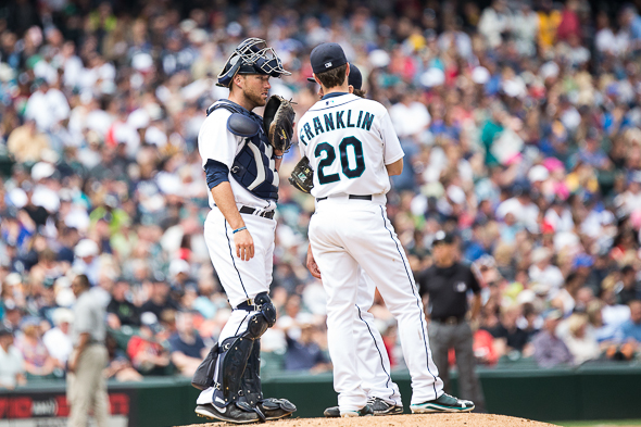 Rookie catcher Brandon Bantz joins rookioe second baseman Nick Franklin on the mound for a chat with pitcher Joe Saunders Saturday against the Yankees. /  Drew McKenzie, Sportspress Northwest