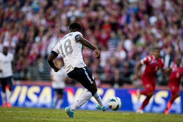 Eddie Johnson sends the ball goalward for the U.S. team's second score in a 2-0 triumph over Panama Tuesday at the Clink in  a World Cup qualifier. / Drew McKenzie, Sportspress Northwest