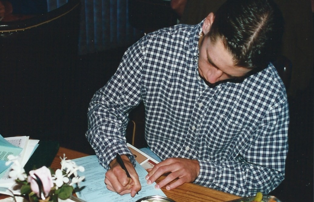 Gerik Baxter signs his pro contract at 13 Coins restaurant. / Baxter family collection