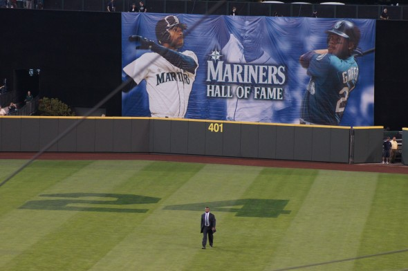 Griffey Jr., shown underneath the giant screen at Safeco Field, walks toward home plate and his induction ceremony into the Mariners Hall of Fame. / Scott Johnson photograph