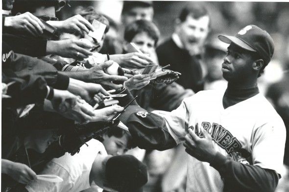 Ken Griffey Jr., signing autographs for fans, will be inducted into the Mariners Hall of Fame Saturday prior to Seattle's game against the Milwaukee Brewers at Safeco Field. / David Eskenazi Collection