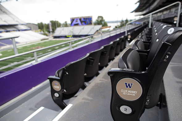 Stadium life gets a little cushier for some fans in the debut of Husky Stadium Saturday./ Drew McKenzie, Sportspress Northwest