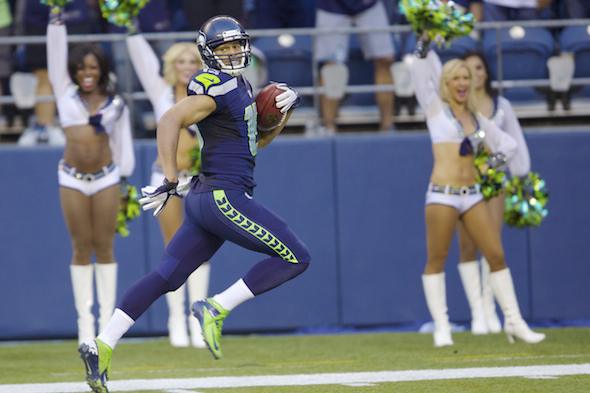 Seahawks WR Jermaine Kearse is close to securing his roster spot after scoring a touchdown on a 107-yard kickoff return. / Drew Sellers