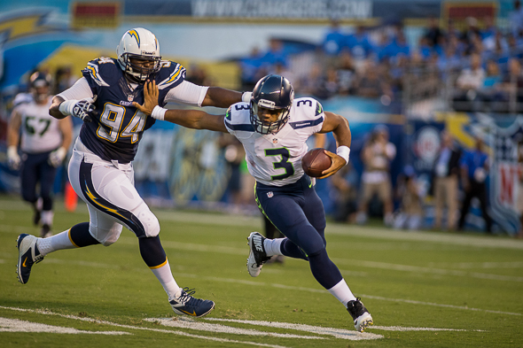 Russell Wilson executed multiple escapes from the Chargers' pass rush Friday in San Diego. / Drew McKenzie, Sportspress Northwest