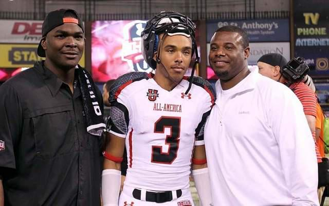 Trey Griffey, joined by his father, Ken, and former NFL star Keyshawn Johnson after his high school career in Orlando concluded. / Wiki Commons