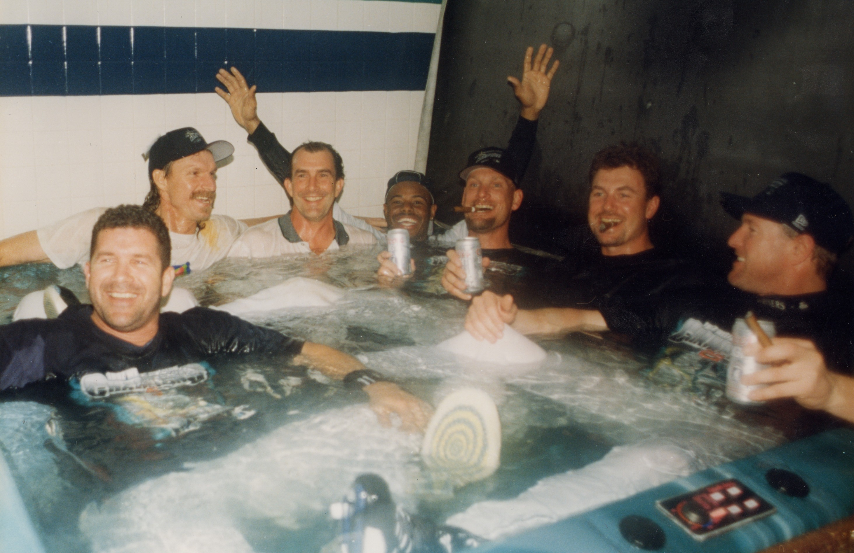 The Kingdome hot-tub party after winning the 1995 ALDS: From left, Edgar Martinez, Randy Johnson, Ken Griffey Jr., /// Mike Blowers and Norm Charlton. / Rick Griffin, Seattle Mariners