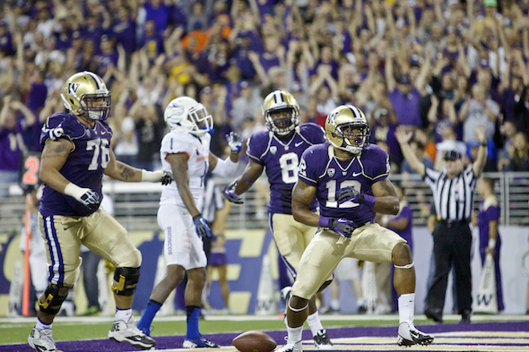 UW TB Dwayne Washington capped the scoring with this eight-yard TD run with 5:56 remaining in the game