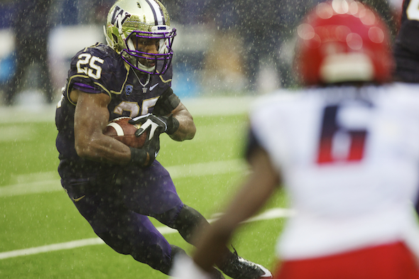 Bishop Sankey ran through Arizona's defense nearly as well as he ran through the raindrops. / Drew Sellers, Sportspress Northwest