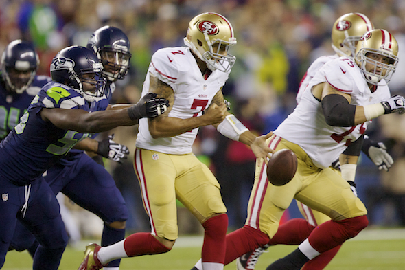 In his first game as a Seahawk, Cliff Avril sacked 49ers quarterback Colin Kaepernick and forced a fumble that Seattle recovered. / Drew Sellers, Sportspress Northwest