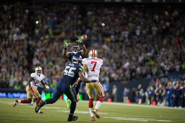The Seahawks' defense held QB Colin Kaepernick to 127 yards passing and sacked him four times. / Drew McKenzie
