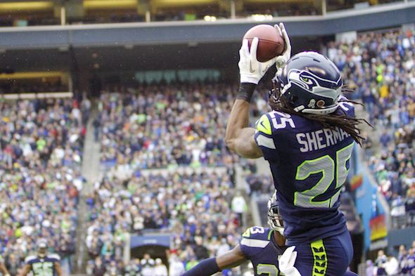 Richard Sherman, as he did against the New York Jets during a Clink game, was in the right place at the right time against the Texans Sunday in Houston. / Drew Sellers, Sportspress Northwest