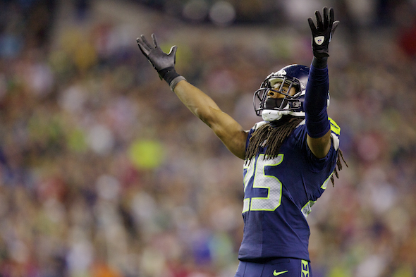 The Seahawks' Richard Sherman takes in the audio waterfall after his interception Sunday night. / Drew Sellers, Sportspress Northwest