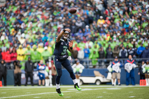 Russell Wilson completed only 14 passes, but four went for touchdowns. / Drew McKenzie, Sportspress Northwest