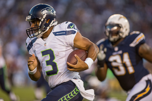 If Russell Wilson seemed to be running for his life Sunday, well, at least some of it was part of the plan. / Drew McKenzie, Sportspress Northwest