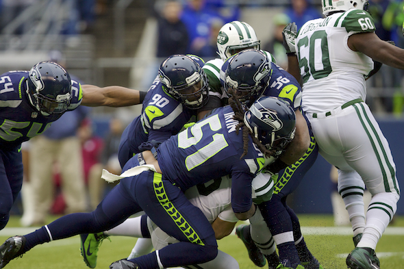 Bruce Irvin had the best game of his career Monday with nine tackles and an interception. / Drew McKenzie, Sportspress Northwest file