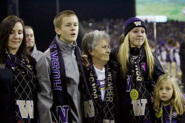 Carol James, wife of the late Don James, and several of their grandchildren, were saluted before the game against Cal Saturday. / Drew Sellers, Sportspress Northwest