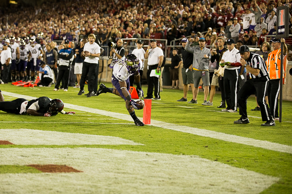 Mickens led the Huskies with nine receptions totaled 59 yards and this one-yard touchdown. / Drew McKenzie