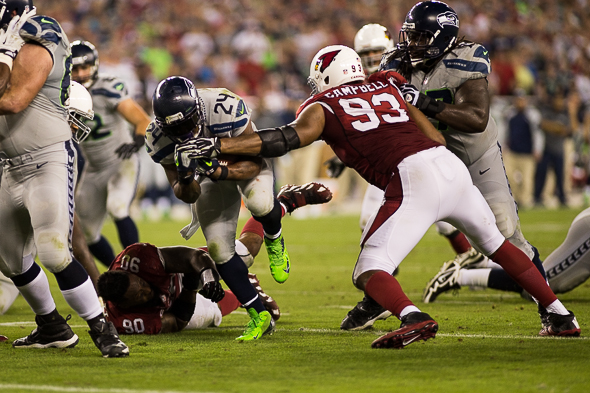 Here is the aftermath of running back Marshawn Lynch nearly beheading Arizona defensive tackle Darnell Dockett. / Drew McKenzie