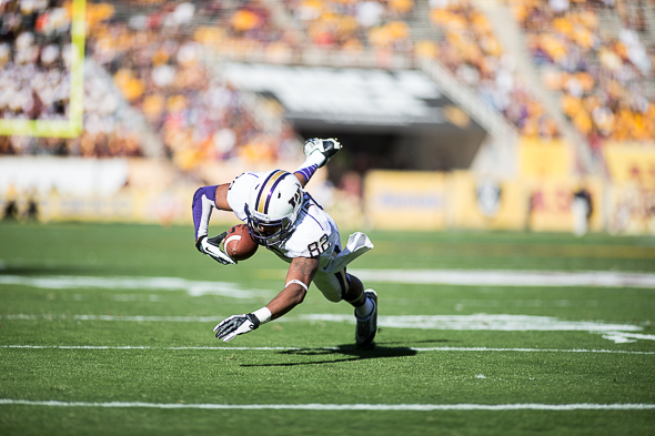 Washington receiver Joshua Perkins stumbles after making a catch during Washington's 53-24 loss at Arizona State Saturday. / Drew McKenzie, Sportspress Northwest