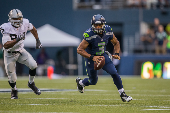 "Russell Wilson said he was more ""in tune"" with the offense in Sunday's win over Tennessee. / Drew Sellers, Sportspress Northwest file"