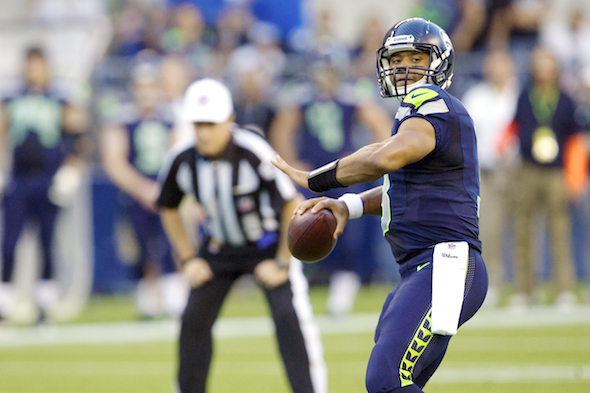 To make the Seahawks passing game work, Russell Wilson needs time he isn't getting. / Drew McKenzie