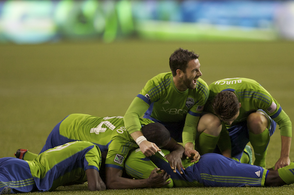 The Sounders celebrate after Eddie Johnson's clinching goal in the 2-0 win over Colorado Wednesday night at the Clink. / Drew Sellers, Sportspress Northwest