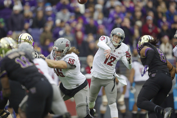 WSU QB Connor Halliday stayed poised for most of four quarters, but two fourth-quarter interceptions proved costly. / Drew Sellers