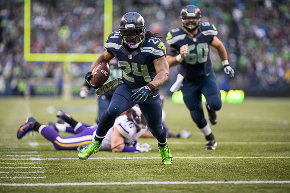 Seahawks running back Marshawn Lynch rushed for just 54 yards but scored three touchdowns. / Drew McKenzie
