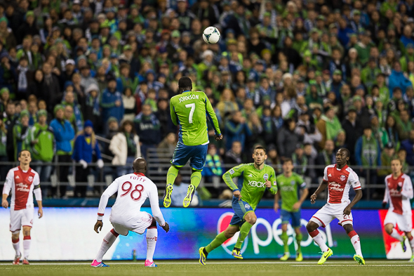 Eddie Johnson heads the ball toward Clint Dempsey Saturday night at the Clink against Portland. / Drew McKenzie, Sportspress Northwest