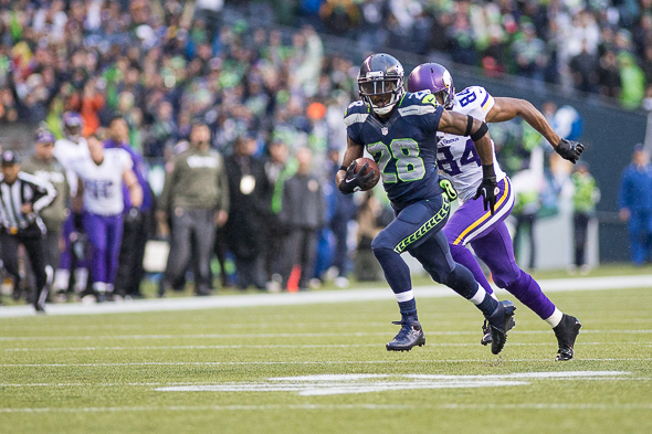 Walter Thurmond takes an interception to the house in Sunday';s win over the Vikings. / Drew McKenzie, Sportspress Northwest