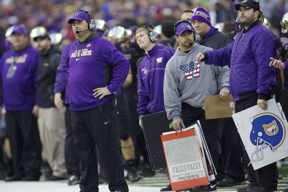 Steve Sarkisian, far left, is shown on the sidelines in his final game as Washington's head coach, last Friday against Washington State in the Apple Cup. / Drew Sellers, Sportspress Northwest