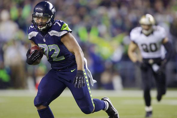 """DE/DT Michael Bennett scored an elusive """"fat guy touchdown"""" in the first quarter. / Drew Sellers"""