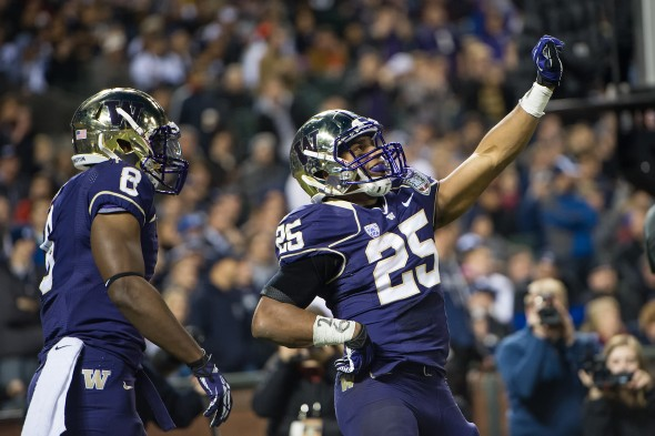 Bishop Sankey celebrates after scoring one of his two touchdowns Friday night in the Huskies' triumph over BYU. / David Bernal Photography