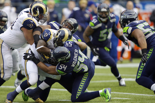 MLB Bobby Wagner helped the Seahawks defense hold the Cardinals to 13 yards rushing, tying a club record. / Drew Sellers, Sportspress Northwest