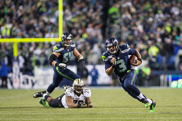 Russell Wilson is separating himself from the NFL's impressive group of young quaterbacks. / Drew McKenzie