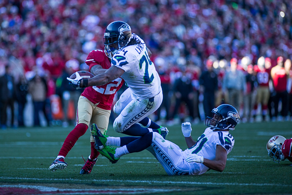Marshawn Lynch has 1,042 yards and ten rushing touchdowns in 2013. / Drew McKenzie