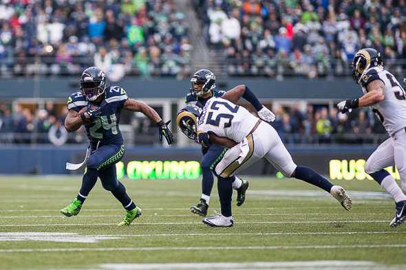 Lynch was a steady runner in Seattle's win and would have likely surpassed 100 yards rushing if he played the entire game. / Drew McKenzie