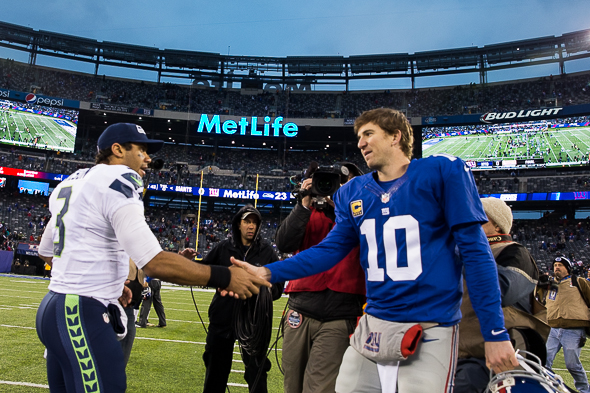 Russell Wilson and Eli Manning meet after the game Sunday. Manning has one game left this season at MetLife Stadium. Maybe Wilson too. / Drew McKenzie, Sportspress Northwest