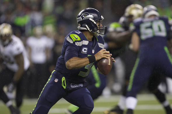 Russell Wilson produced his third consecutive Total QBR 90.0 against the Saints Monday night in Seattle's 34-7 victory. / Drew Sellers, Sportspress Northwest