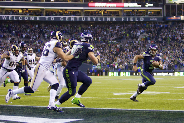 The rushing of Russell Wilson has become less effective as defenders gear up to stop him. / Drew McKenzie, Sportspress Northwest