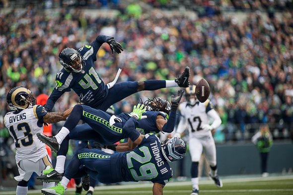 The Legion of Boom were too good for their own good. Byron Maxwell (41), Richard Sherman (25) and Earl Thomas (29) arrived in the end zone at the same time to deny the ball to the Rams' Chris Givens, as well as themselves / Drew McKenzie, Sportspress Northwest