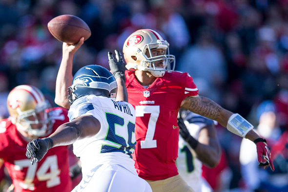 San Francisco quarterback Colin Kaepernick has struggled in his two appearances at CenturyLink Field. The 49ers and Seahawks battled Sunday for the right to play in the Super Bowl. / Drew McKenzie, Sportspress Northwest