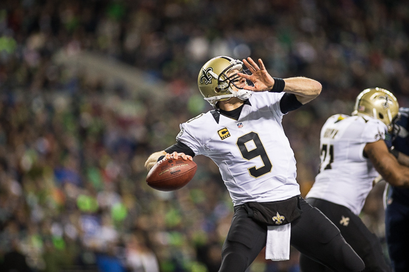 Drew Brees is likely to revert to this form Saturday, rather than handing off. / Drew McKenzie, Sportspress Northwest