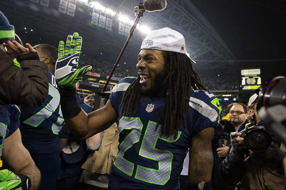 Richard Sherman sent the Seahawks to the Super Bowl with a final-second tip. His post-game interviews garnered as much attention. / Drew McKenzie, Sportspress Northwest