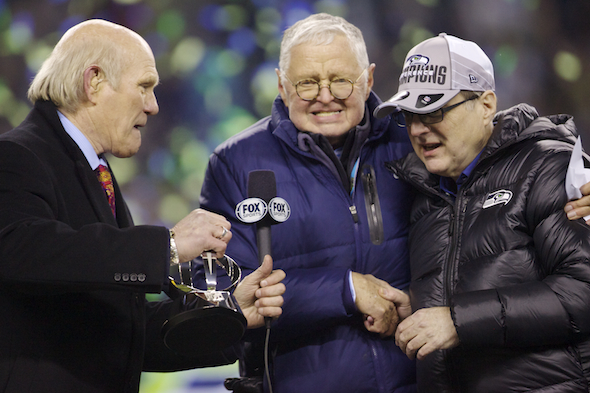 As broadcaster Terry Bradshaw watches John Nordstrom and Paul Allen celebrate. / Drew Sellers, Sportspress Northwest