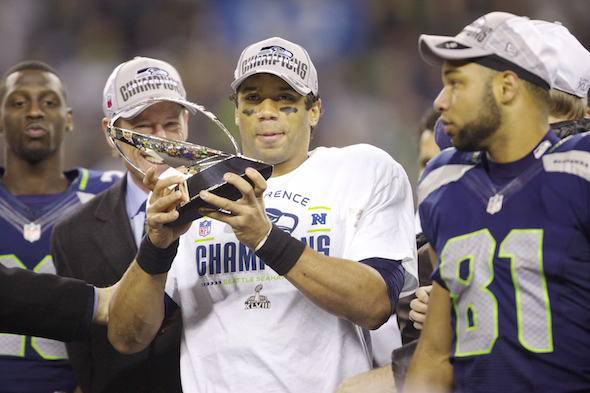 Russell Wilson and crew: One trophy down, one to go. / Drew Sellers, Sportspress Northwest