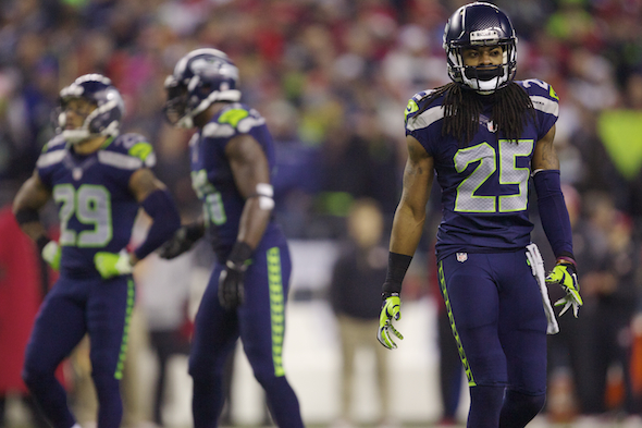 The final play by Seahawks CB Richard Sherman sent the Seahawks to the Super Bowl. His post-game antics sent him into the national discussion. / Drew Sellers, Sportspress Northwest